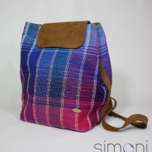 Woven stripped backpack and leather