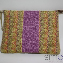 Woven zip clutch with patterns