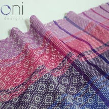 woven shawl with patterns and stripes details