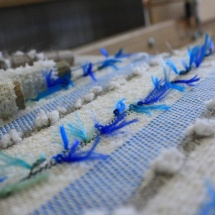 Weaving the blue and neutral cushions