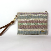 Hand-woven stripped purse with suede leather