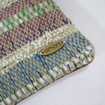 Hand-woven stripped purse with suede leathe