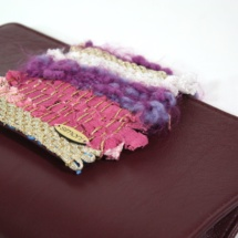 Leather Burgundy clutch with woven fabric