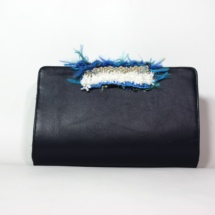 Blue leather clutch with woven fabric