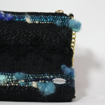 Black and blue purse with chain detail