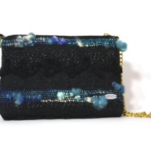 Black and blue purse with chain front