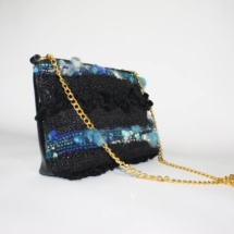 Black and blue purse with chain side