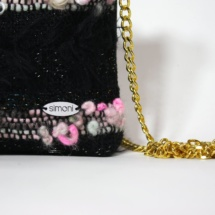 Pink and black purse with chain detail