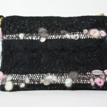 Pink and black purse with chain front