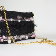 Pink and black purse with chain side