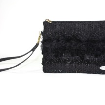 Total black purse with texrures front