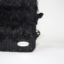 Total black purse with texture details
